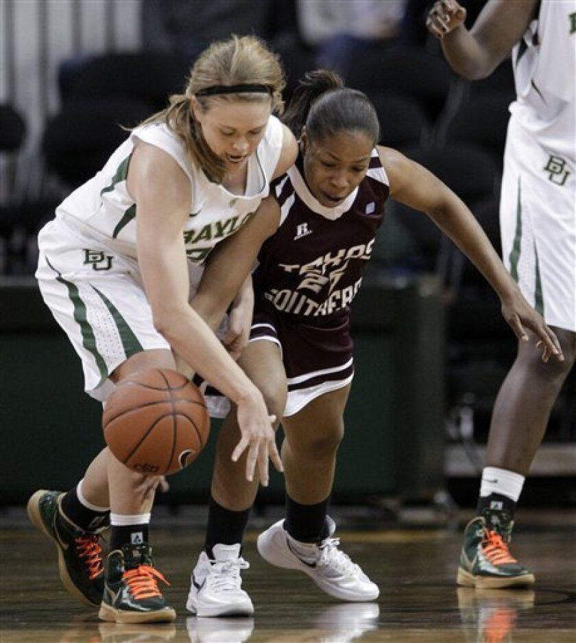 Baylor's Lindsay Palmer, left, and Texas Southern' Azalea Hall, right, scramble for a loose ball in the second half of an NCAA college basketball game Wednesday, Nov. 30, 2011, in Waco, Texas. Baylor won 91-39. (AP Photo/Tony Gutierrez)