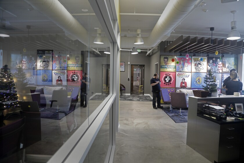 """LOS ANGELES, CA -- DECEMBER 11, 2018: The lobby of comedy podcasting network """"Earwolf"""" with posters"""