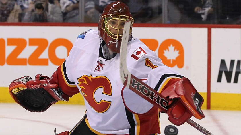 Former Ducks goalie Jonas Hiller is trying to help the Calgary Flames advance into a second-round series against Anaheim.