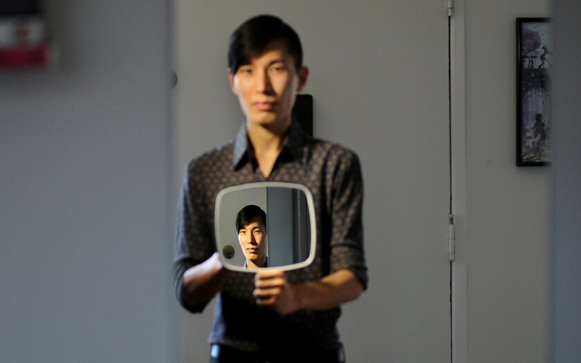 Data scientist Tuck Ngun is photographed at home in Los Angeles on Wednesday, October 7, 2015. Ngun's study revealed that a DNA test may point to indicators of sexual orientation.