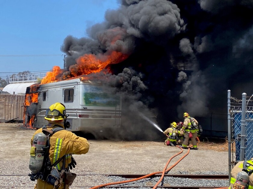 Firefighters on Wednesday battled a motorhome blaze at Shuster Oil in Escondido.
