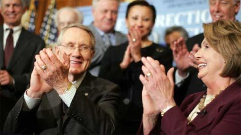 APPLAUSE: Senate Majority Leader Harry Reid and Speaker of the House Nancy Pelosi are all smiles after signing an energy bill that included the first congressional increase in vehicle fuel-economy standards in 32 years. President Bush is scheduled to sign it today.