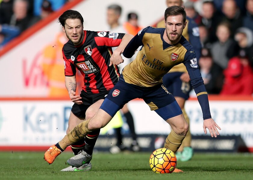 Arsenal's Aaron Ramsey, right, and AFC Bournemouth's Harry Arter battle for the ball during the English Premier League soccer match between Bournemouth and Arsenal,  at the Vitality Stadium, in Bournemouth, England, Sunday Feb. 7, 2016. (John Walton/PA via AP) UNITED KINGDOM OUT