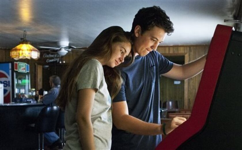 """This publicity image released by A24 Films shows Shailene Woodley, left, and Miles Teller in a scene from """"The Spectacular Now."""" (AP Photo/A24 Films)"""