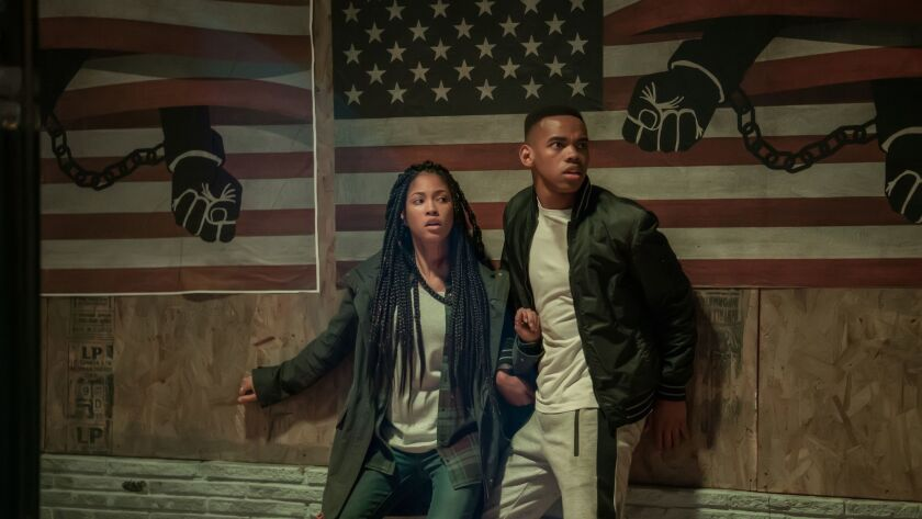 """Lex Scott Davis and Joivan Wade in """"The First Purge"""" movie."""