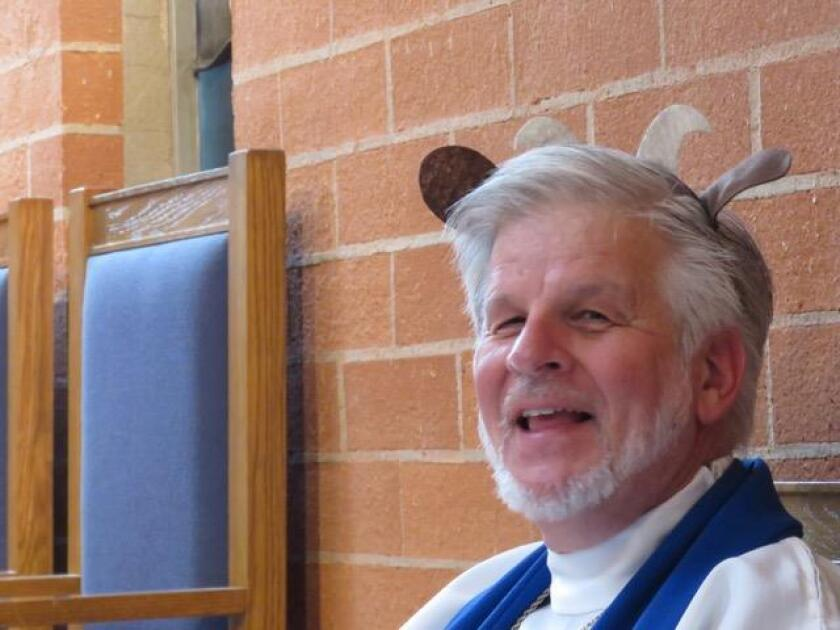 The Rev. Larry Koger is shown modeling fake goat ears for a children's Christmas pageant.