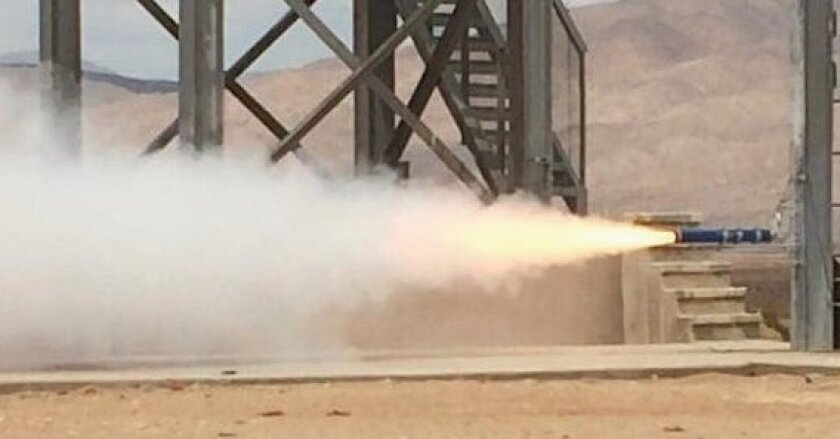 The Triton Rocket Club test fired the engine of a rocket that was successfully sent more than 15,000 feet into the atmosphere.