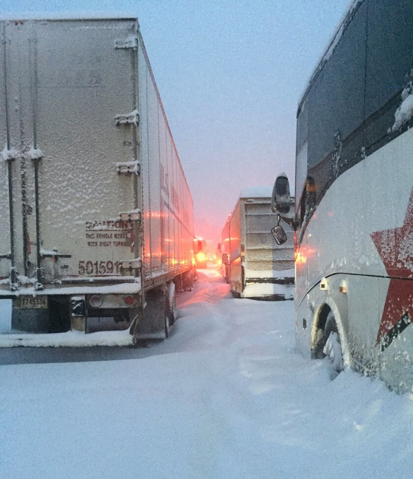 In this photo provided by Dave Saba, traffic is at a standstill on the Pennsylvania Turnpike near Somerset, Pa., Saturday, Jan. 23, 2016. The Duquesne men's basketball team and Temple University's women's gymnastics team are stuck on the Turnpike due to treacherous weather conditions. A mammoth winter storm crawled up the U.S. East Coast on Saturday, making roads impassable, shutting down mass transit, and bringing Washington and New York City to a standstill. (Dave Saba via AP)