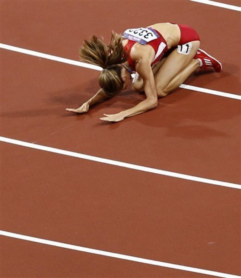 United States' Morgan Uceny reacts after falling during the women's 1500-meter final during the athletics in the Olympic Stadium at the 2012 Summer Olympics, London, Friday, Aug. 10, 2012. (AP Photo/Daniel Ochoa De Olza)