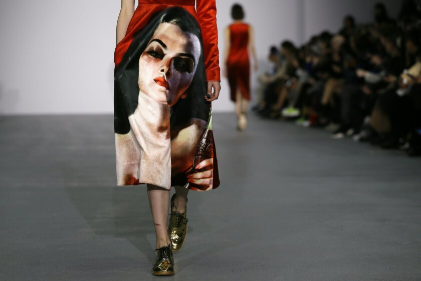 A model displays a design during the Fyodor Golan Autumn/Winter show at London Fashion Week, Friday, Feb. 19, 2016. (AP Photo/Kirsty Wigglesworth)
