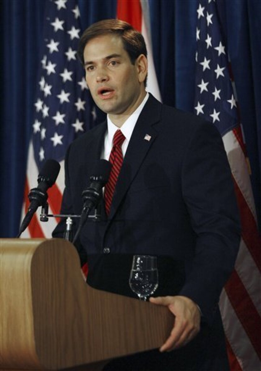 FILE - In this Nov. 3, 2010 file photo, Florida Sen.-elect Republican Marco Rubio holds a press conference at the Biltmore Hotel in Coral Gables, Fla. Florida Sen. Marco Rubio, a breakout star of the 2010 election and a favorite of the tea party, kept a low profile during his first three months in the Senate. That's begun to change. (AP Photo/Jeffrey M. Boan, File)