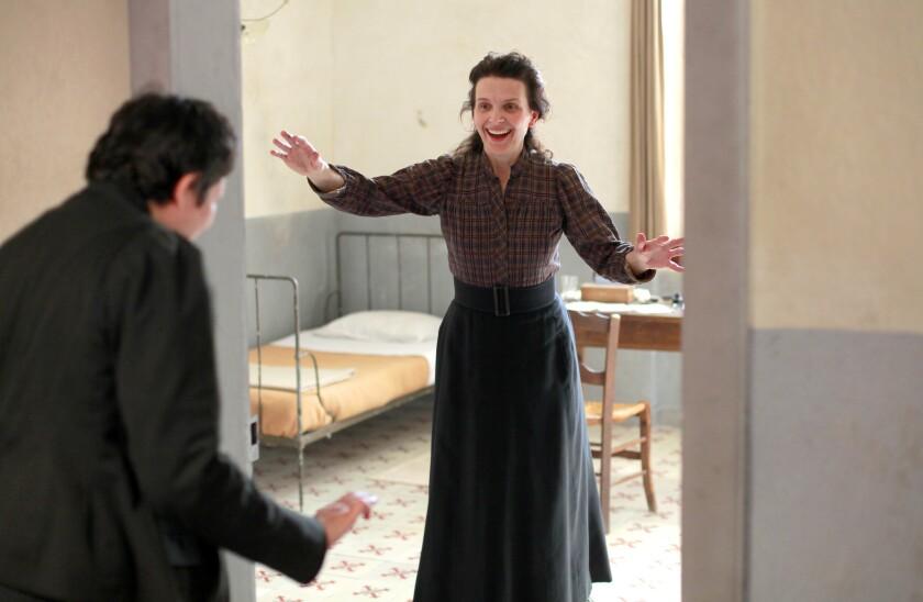 "Alexandra Lucas as Mademoiselle Lucas and Juliette Binoche as Camille Claudel in ""Camille Claudel 1915."""