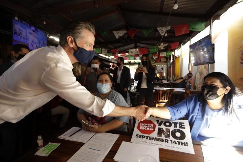 Gov. Gavin Newsom greets campaign volunteers at Hecho en Mexico restaurant in El Sereno on Aug. 14.