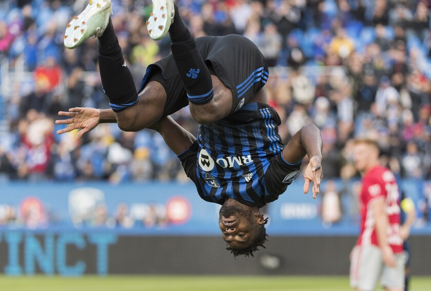 Montreal Impact's Orji Okwonkwo celebrates after scoring against the New York Red Bulls during the second half of an MLS soccer match in Montreal, Sunday, Oct. 6, 2019. (Graham Hughes/The Canadian Press via AP)