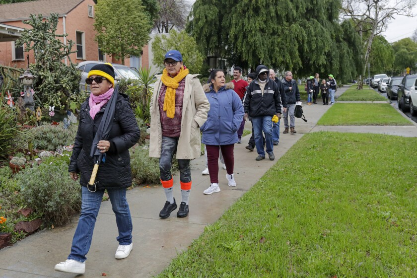 """A group of housing insecure and homeless people and families and their supporters rally on Sheffield Avenue on Saturday morning to """"reclaim"""" a vacant house that they say is owned by Caltrans."""