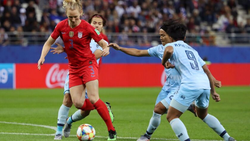 U.S. midfielder Samantha Mewis splits Thailand defenders during their opening Women's World Cup game on Tuesday.