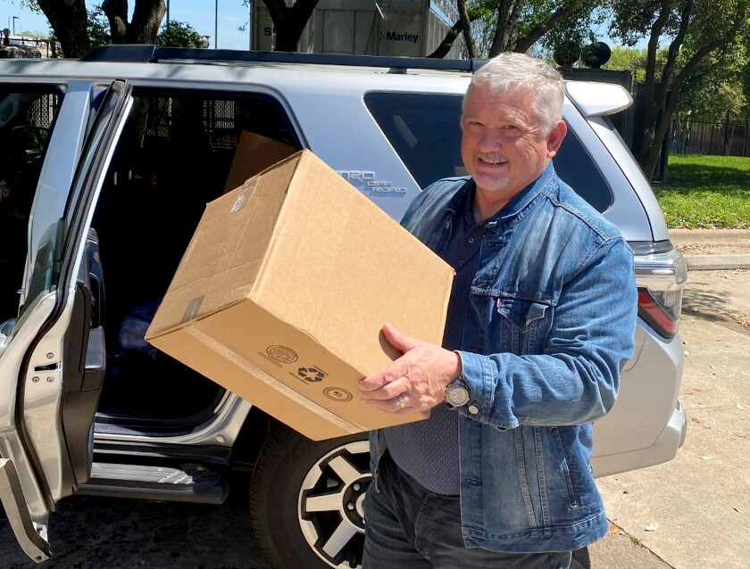 Val Stark, who works for Catalyst Health Network, a firm that provides services to medical practices in Texas, drove to Austin to pick up masks for physicians in the Dallas-Fort Worth areas.