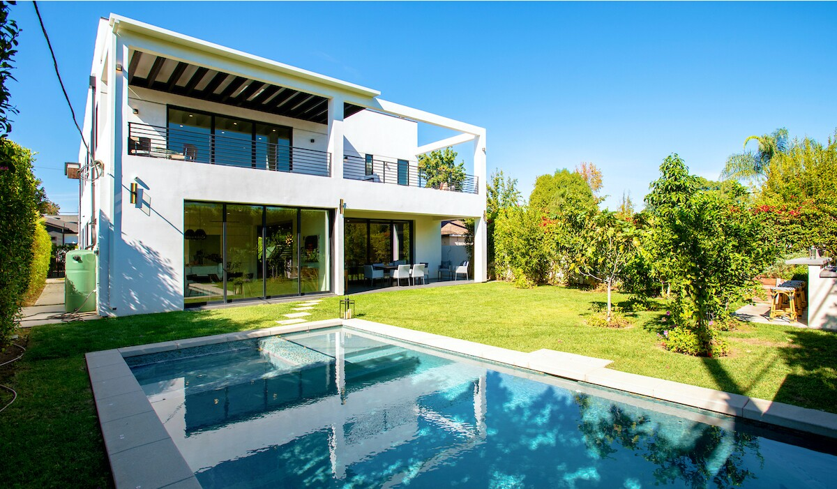Built in 2017, the stylish six-bedroom home expands to three upper-level terraces and a backyard with a fountain-fed pool and spa.