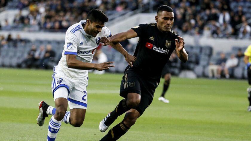Montreal Impact midfielder Shamit Shome (28) vies with Los Angeles FC defender Eddie Segura (4) of C