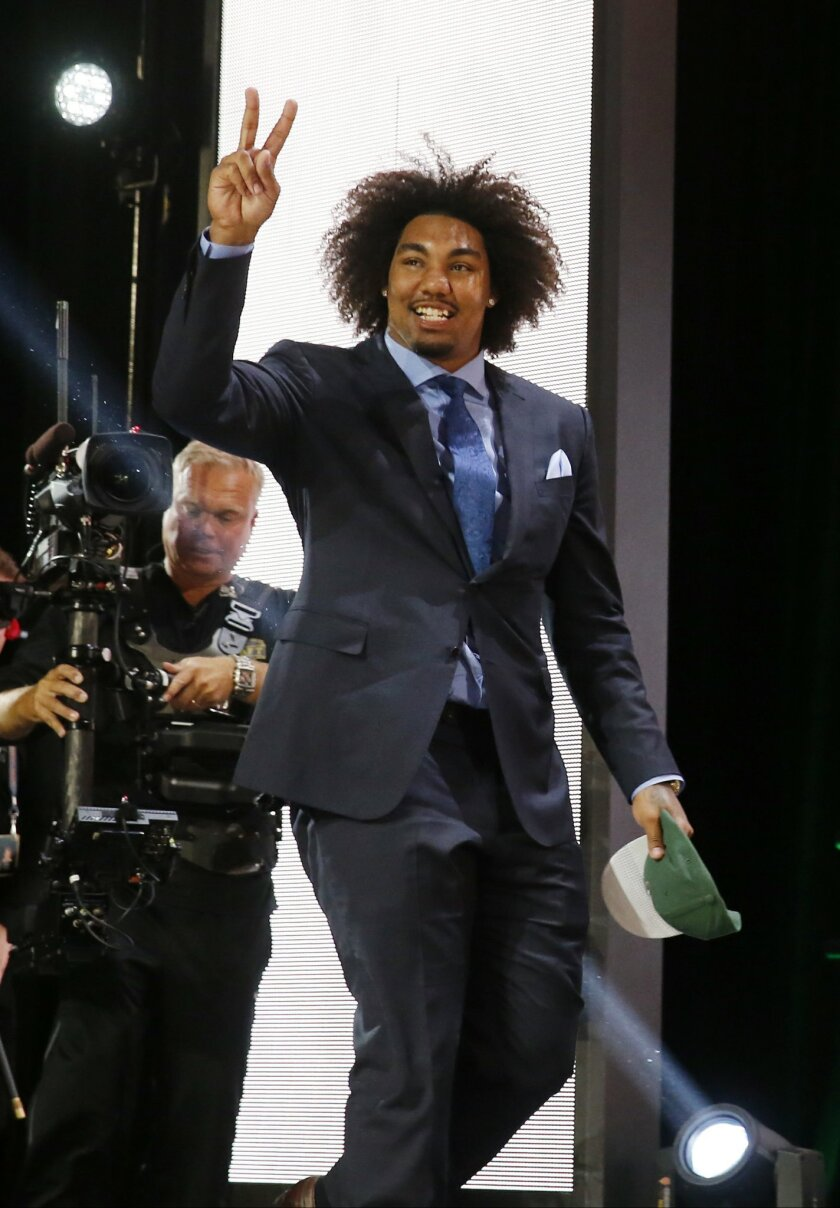 USC defensive lineman Leonard Williams celebrates after being selected by the New York Jets as the sixth pick in the first round of the 2015 NFL Draft,  Thursday, April 30, 2015, in Chicago. (AP Photo/Charles Rex Arbogast)