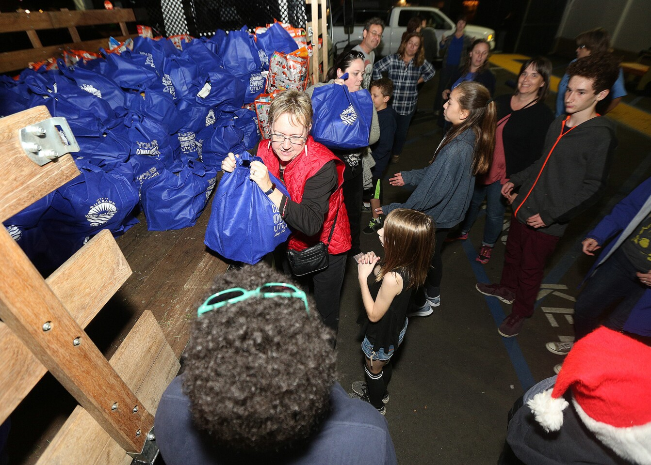 Photo Gallery: Burbank Coordinating Council holiday food and toy donation preparations for delivery