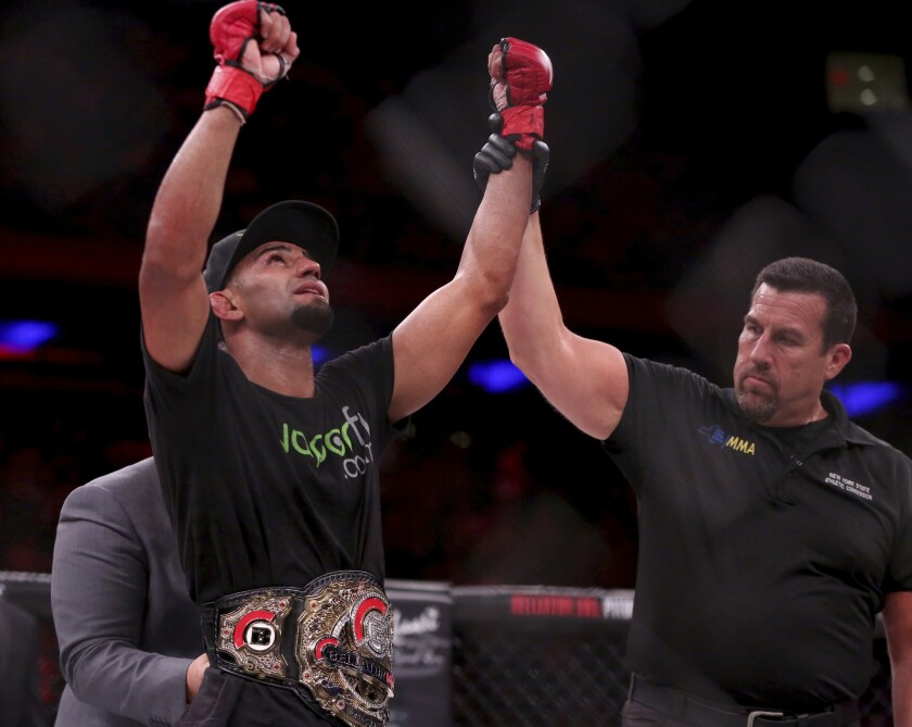 Douglas Lima celebrates after retaining his welterweight belt with a victory over Lorenz Larkin at Bellator 180 in New York City on June 24, 2017.