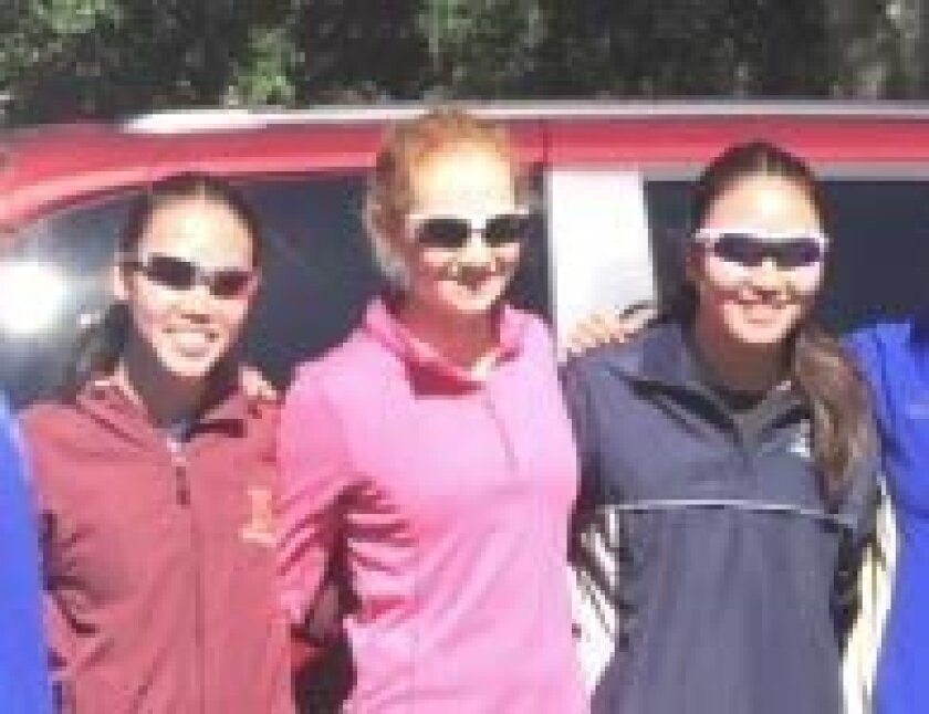 At a pre-race practice with collegiate girls (L-R): Heather Zhang, Tri-Club teammate Jessica Tomasek, and Leslie Zhang.
