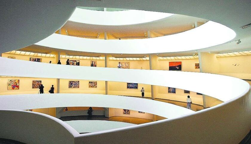 "The spiral ramps of the interior of New York's Guggenheim Museum display works of the ""From Picasso to Pollock: Classics of Modern Art"" exhibit, Tuesday, July 1, 2003, that opens July 4, 2003."