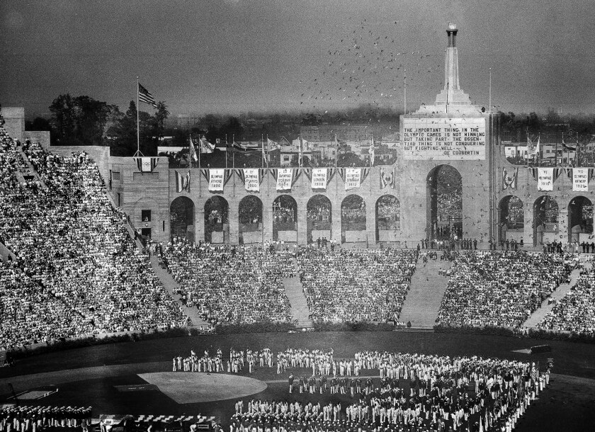 Doves are released during the opening ceremonies of the Tenth Olympiad at the Coliseum in Los Angeles.