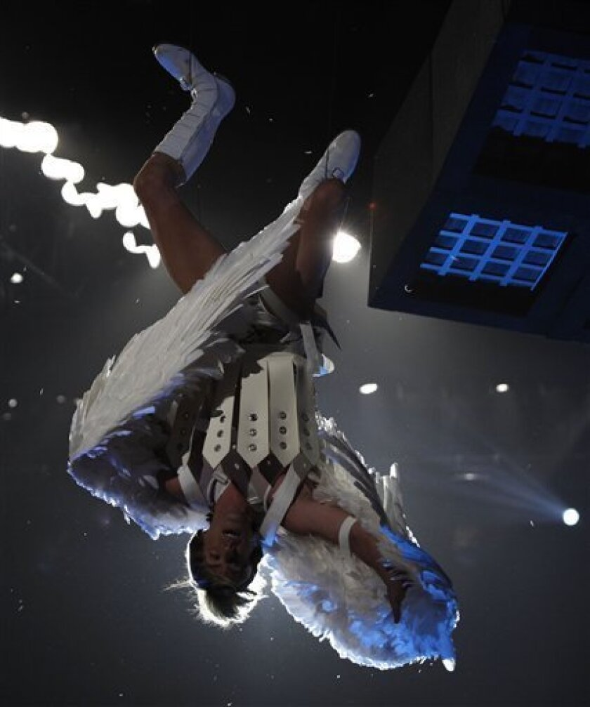 Sacha Baron Cohen, in character as Bruno, is lowered into the audience during the MTV Movie Awards on Sunday May 31, 2009, in Universal City, Calif.  (AP Photo/Matt Sayles)