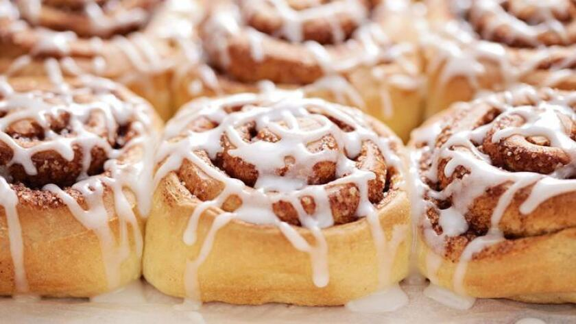 Grab a gooey, delicious cinnamon roll at one of these spots around town to satisfy your fall cravings. (Shutterstock)