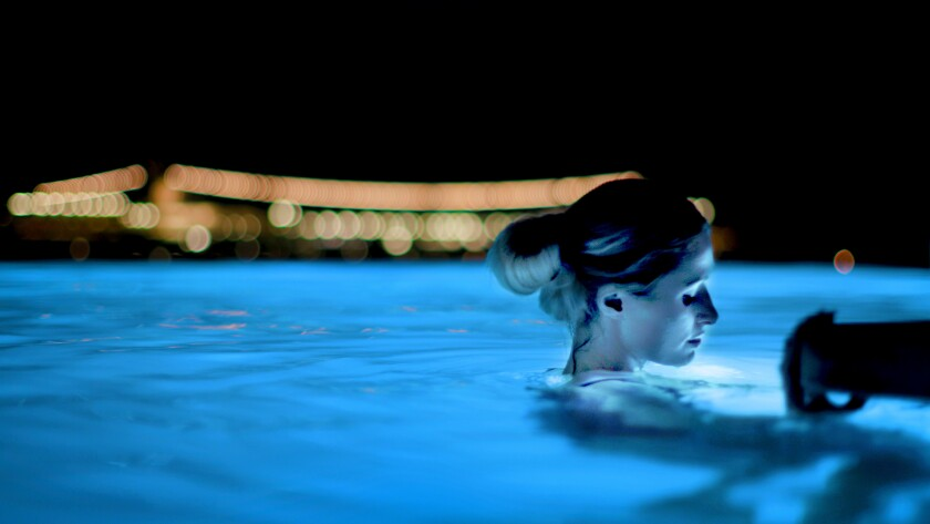 "Paris Hilton reflects in a Mykonos pool in a scene from ""This Is Paris."""