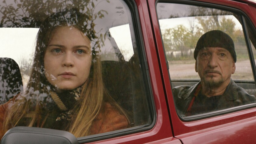 "Hera Hilmar and Ben Kingsley in the movie ""An Ordinary Man."""