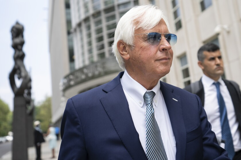 Horse trainer Bob Baffert leaves federal court, Monday, July 12, 2021, in the Brooklyn borough of New York. A New York federal judge seems sympathetic to Baffert's claims that his May suspension by the New York Racing Association was unconstitutional after Kentucky Derby winner Medina Spirit failed a postrace drug test. (AP Photo/John Minchillo)