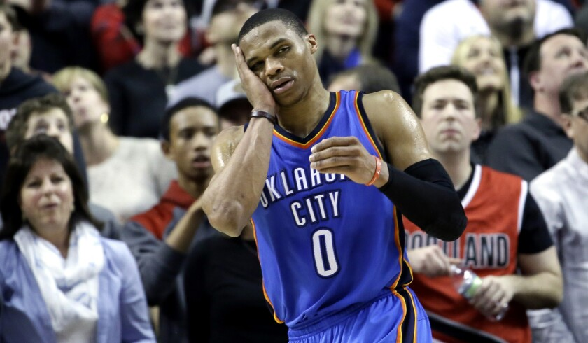 Oklahoma City Thunder point guard Russell Westbrook holds his cheek during the final seconds of the game against the Trail Blazers on Friday night in Portland.