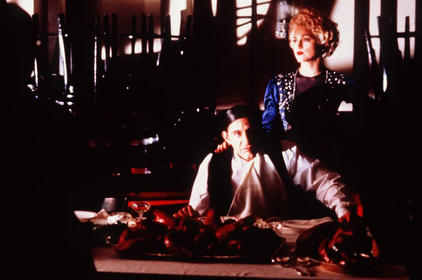 """A scene from 1990 summer hit """"Dick Tracy"""" with Al Pacino and Madonna."""