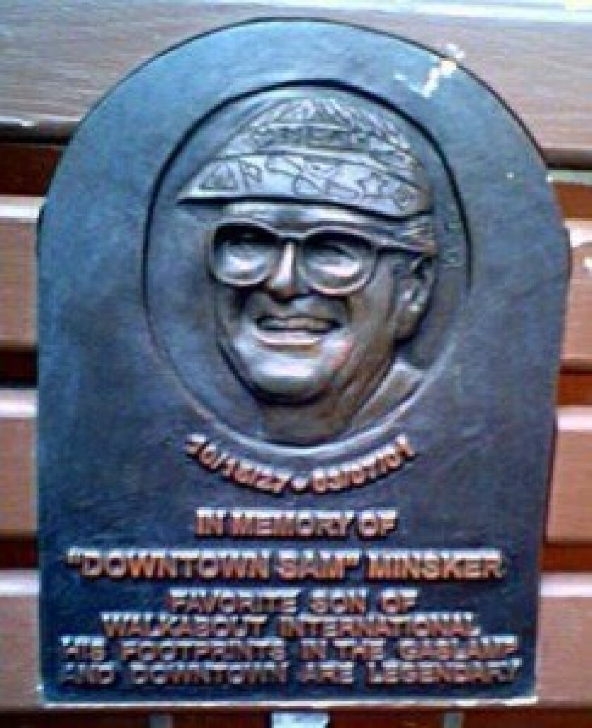 "A plaque in memory of the late Walkabout International tour guide ""Downtown"" Sam Minsker adorns a bench outside the William Heath Davis House in downtown San Diego."