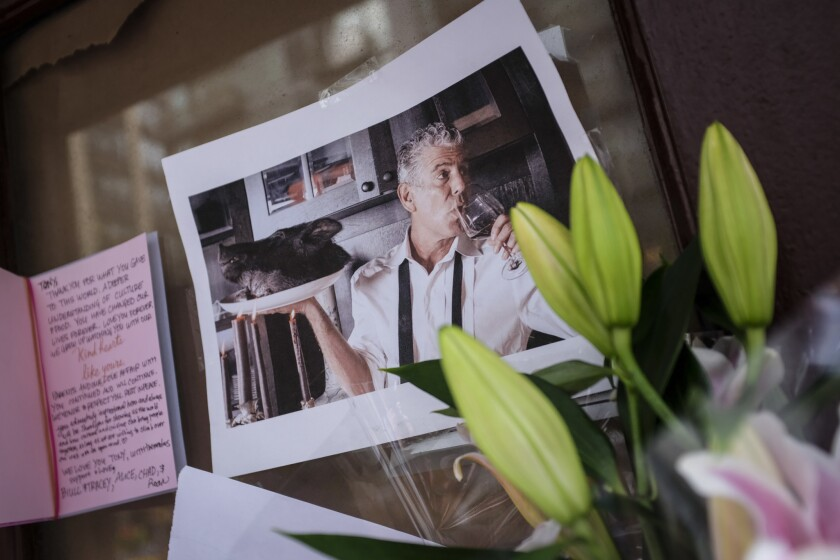 Mourners Leave Flowers At Anthony Bourdain's Former Restaurant, After His Suicide Death
