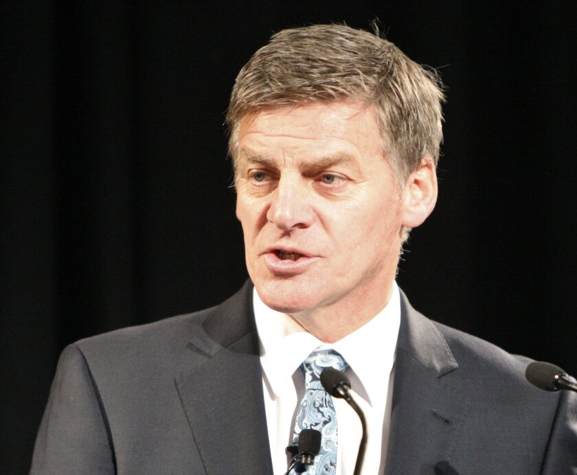 Finance Minister Bill English discusses the annual budget with analysts and the media in Wellington, New Zealand,  Thursday, May 26, 2016. Smokers and polluters in the country will get hit with higher taxes as part of the government's economic plan. (AP Photo/Nick Perry)