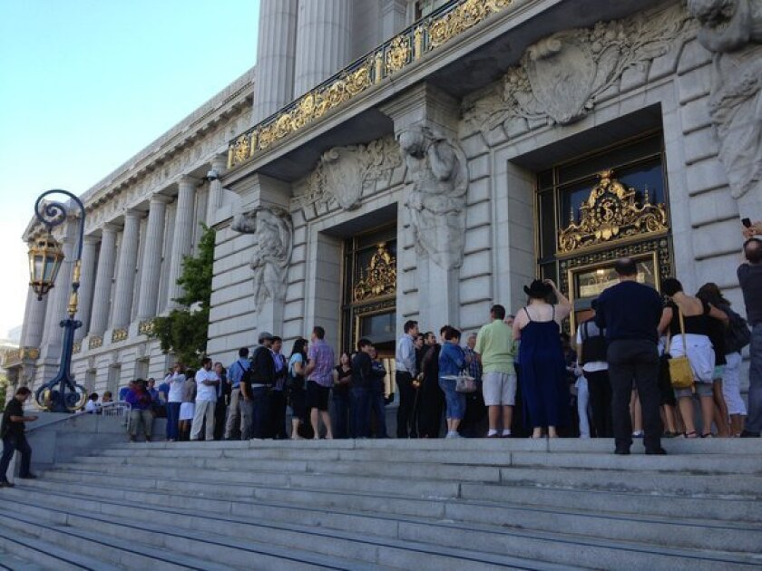Dozens line up early at San Francisco City Hall to get married