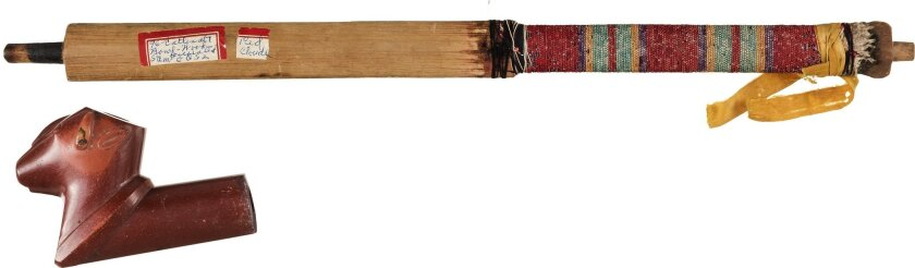 This April 2016 photo provided by Heritage Auctions, HA.com, shows a ceremonial pipe of Chief Red Cloud. It is one of more than 100 items collected from the Pine Ridge and Rosebud Indian Reservations in South Dakota that will be auctioned on June 11, 2016. (Mark Roppolo/Heritage Auctions, HA.com vi