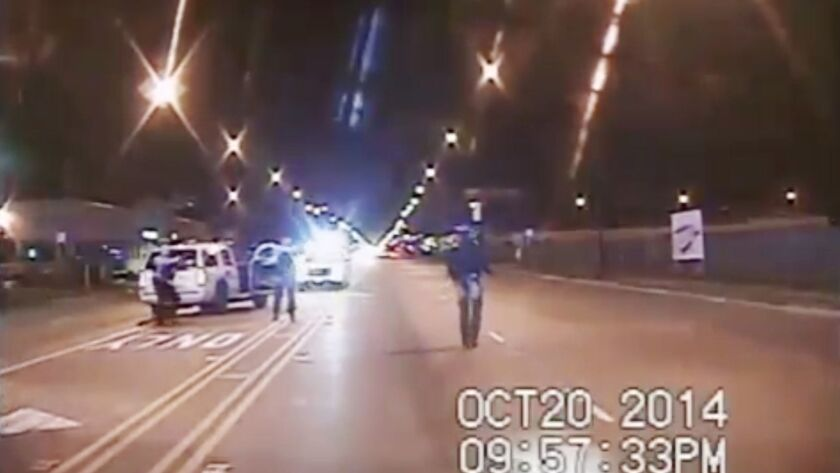 In this Oct. 20, 2014 frame from dash-cam video provided by the Chicago Police Department, Laquan Mc