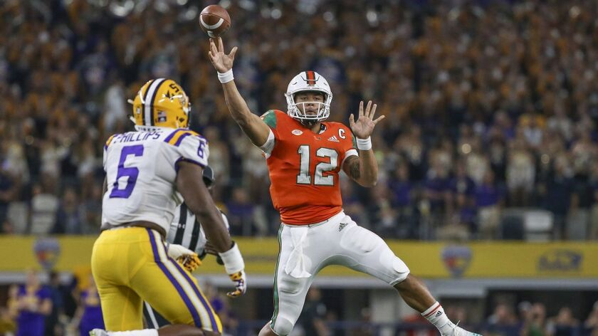 Miami Hurricanes quarterback Malik Rosier (12) passes in the first quarter against the LSU Tigers during the AdvoCare Classic on Sept. 2, 2018, at AT&T Stadium in Arlington, Texas.