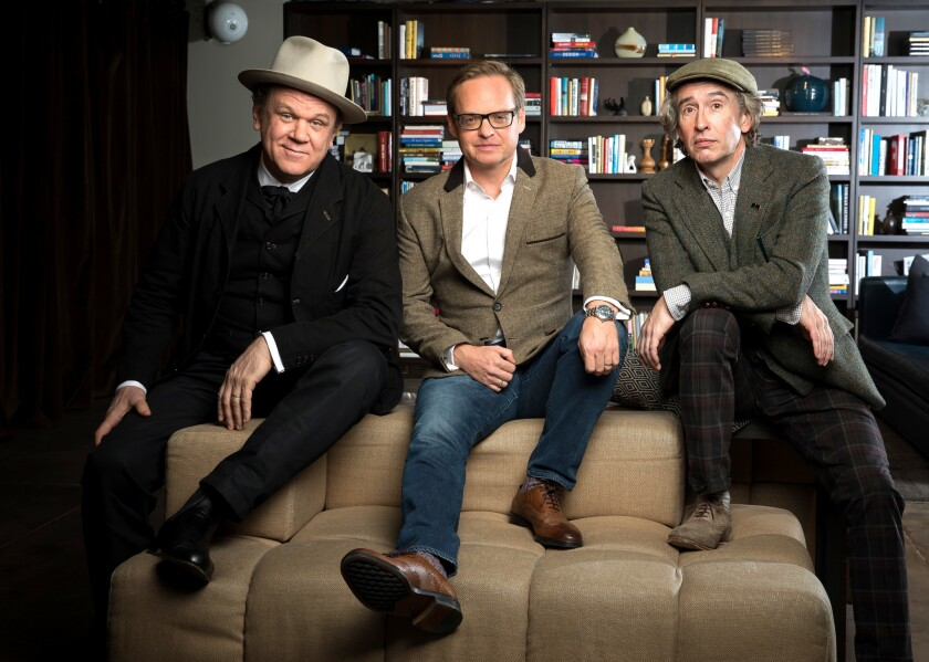 """Director Jon S. Baird, center, and actors John C. Reilly, left, and Steve Coogan, right, are the team behind the movie """"Stan & Ollie. Photographed at Neuehouse in New York City."""