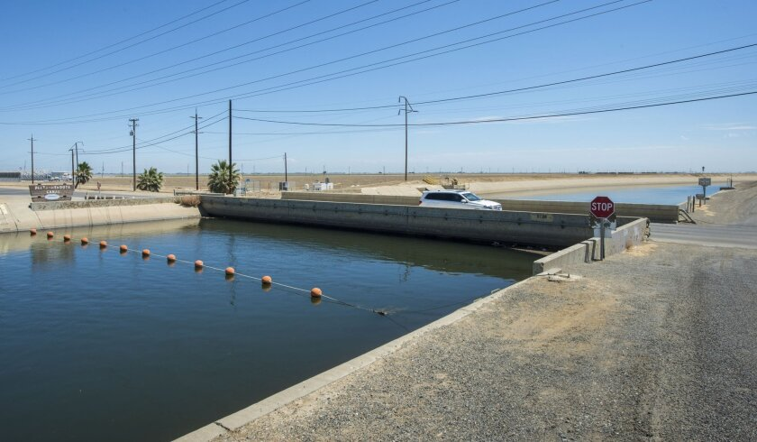 The Russell Avenue bridge in Firebaugh, Calif., has sunk so much it is almost touching the surface of the water in the Delta-Mendota Canal.