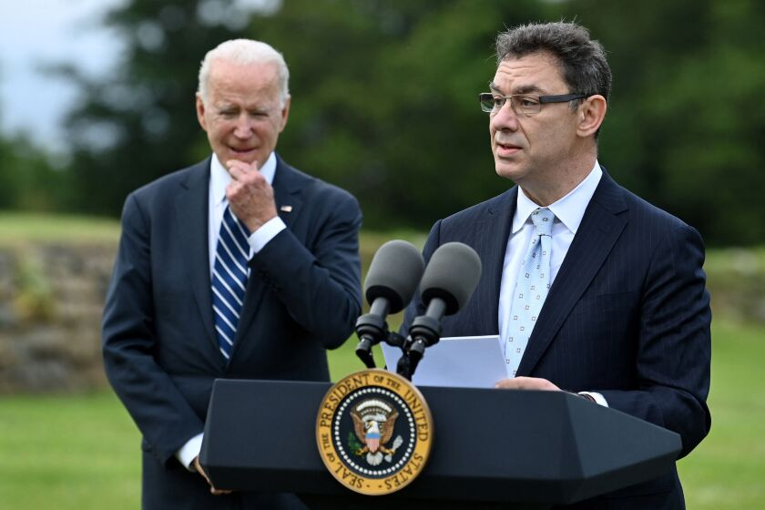 Pfizer CEO Albert Bourla gives a speech as President Biden looks on in Cornwall, England, ahead of the G-7 summit.
