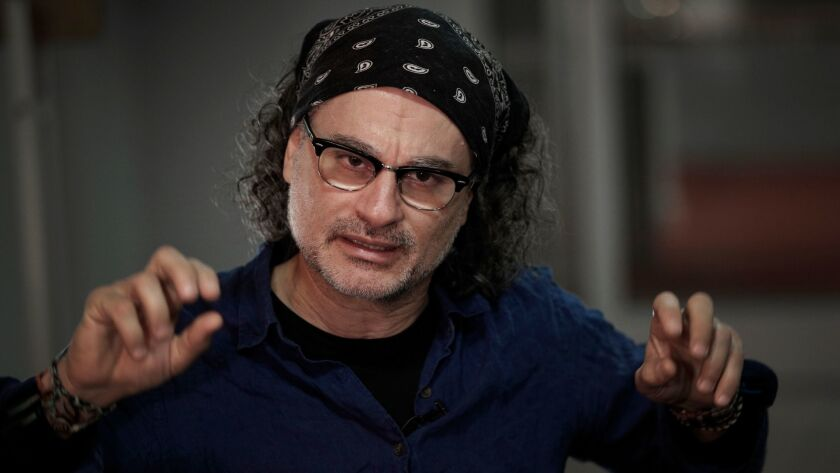 Lebanese director Ziad Doueiri poses during an interview with Associated Press in Paris, Wednesday,
