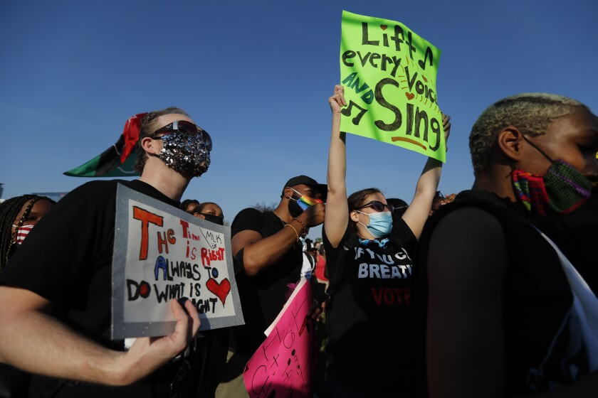 In this June 19, 2020, photo, people attend a peaceful rally in Chicago to mark Juneteenth. The holiday celebrates the day in 1865 that enslaved black people in Galveston, Texas, learned they had been freed from bondage, more than two years after the Emancipation Proclamation. (AP Photo/Charles Rex Arbogast)