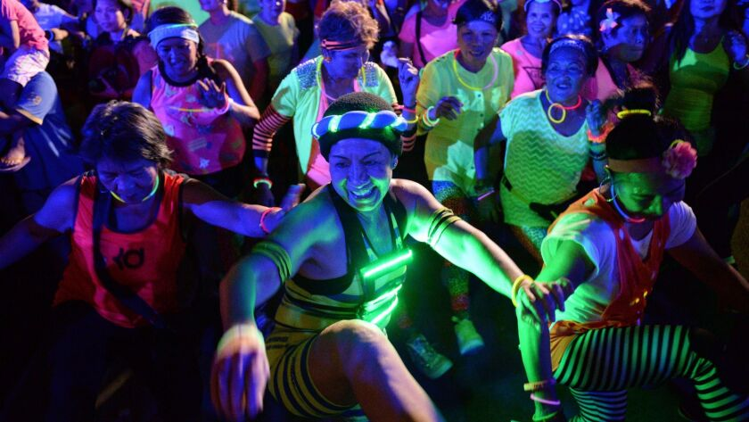 The Colombian dance-based exercise called Zumba has spread around the world, as shown in this Zumba class in Manila, Philippines.