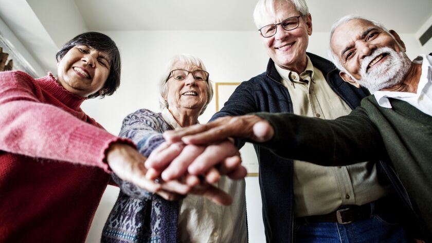 Group of senior friends support concept